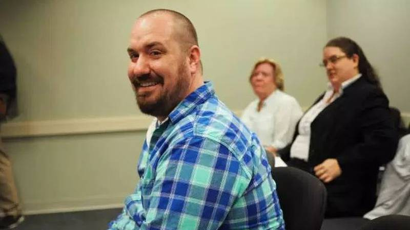 Adam Trimmer, 29, watches his mom speak against conversion therapy during a Board of Counseling...