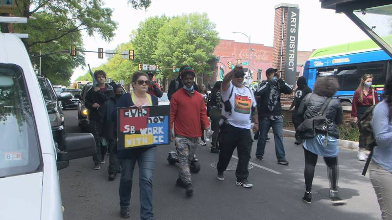 Students and community members took to the streets to protest plans for a new school in Richmond.