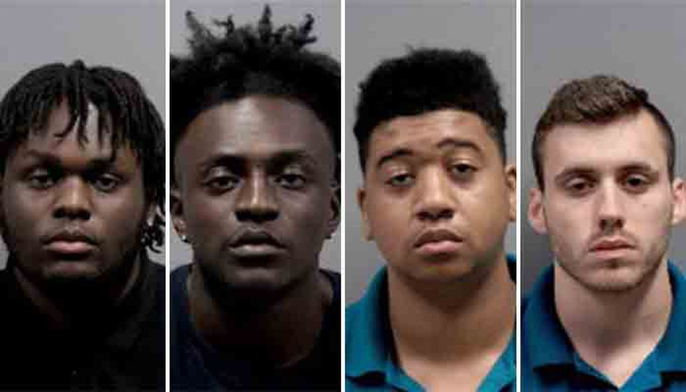 From left, Aaron Terill Grier, Daniel Eugene Shawn Grier, Michael Gerard Parrish and Ryan...