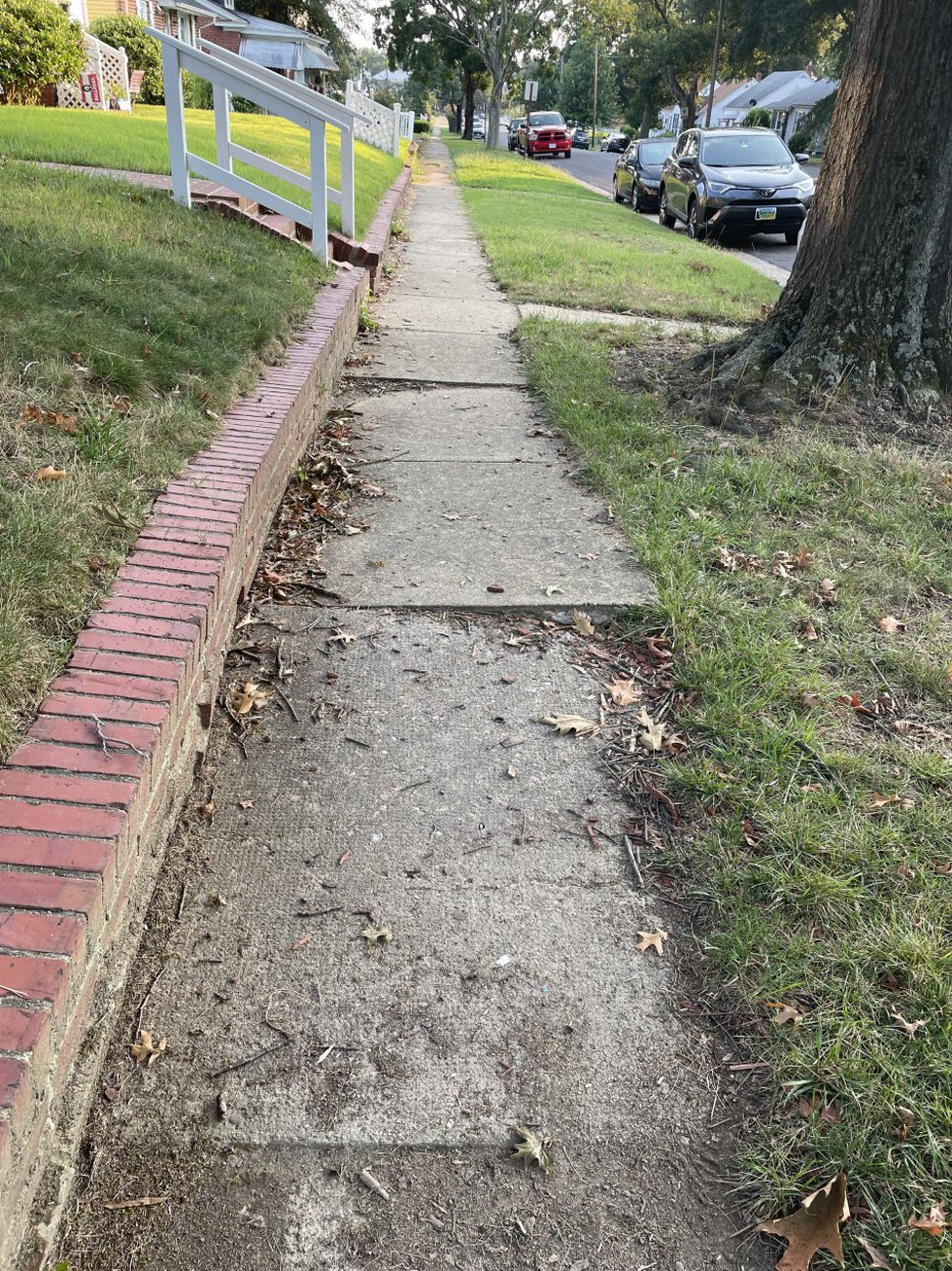 A sidewalk in one Church Hill neighborhood was buckling, uneven and residents feared, not...