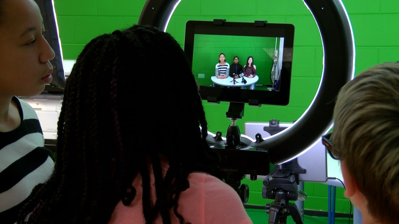A group of fifth-graders at Dupont Elementary School run a newscast as part of the school's...