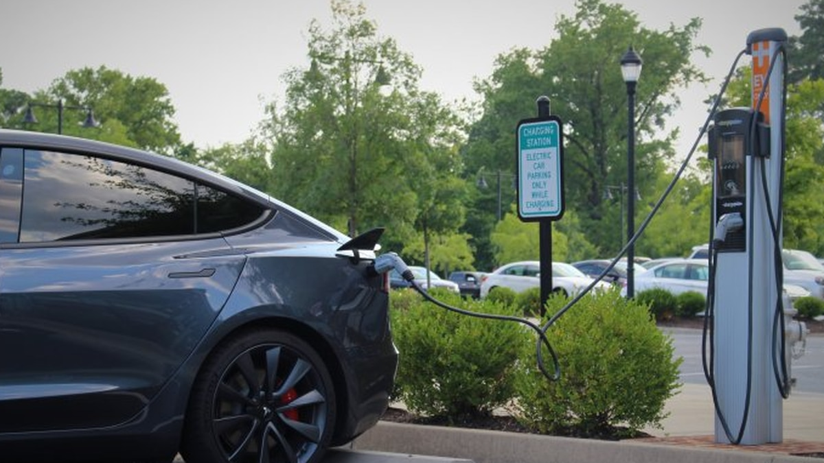An electric vehicle charges at a public station in Henrico County, July 2020.