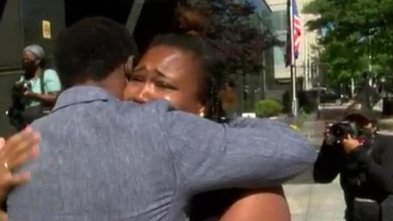Mayor Stoney hugs protester.