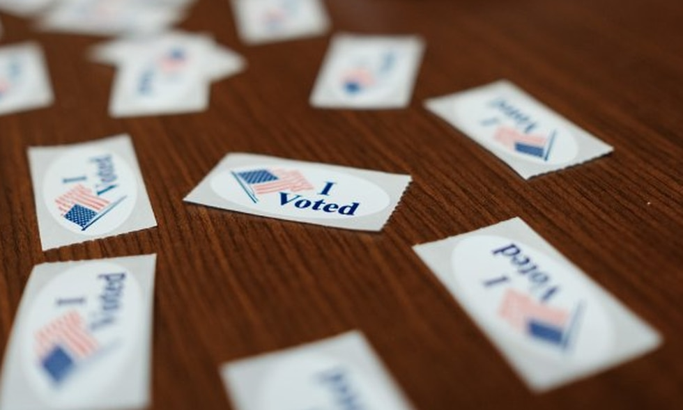 """""""I Voted"""" stickers spread out on a table at a polling place in Richmond."""