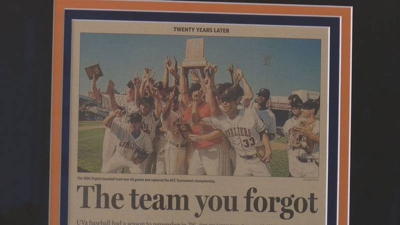 A newspaper clipping about the 1996 ACC champion Virginia baseball team hangs in John...