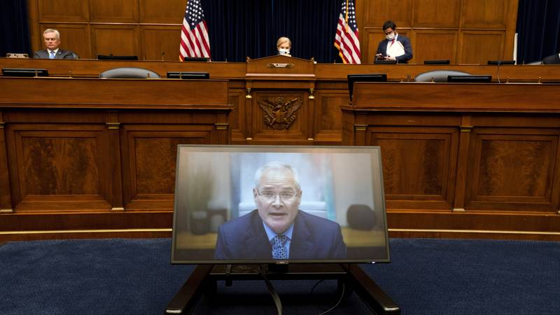 Darren Woods, CEO of ExxonMobil, testifies via video conference during a House Committee on...