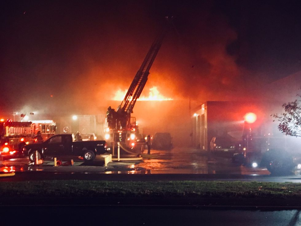 Fire crews are on scene of a large warehouse fire near the Manchester area.