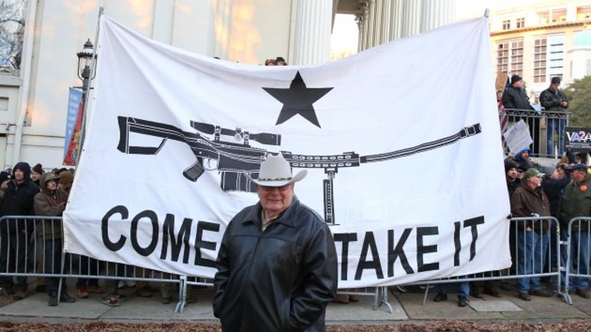 A banner and pro-gun rally attendees line up near Grace and Ninth streets in Downtown Richmond...