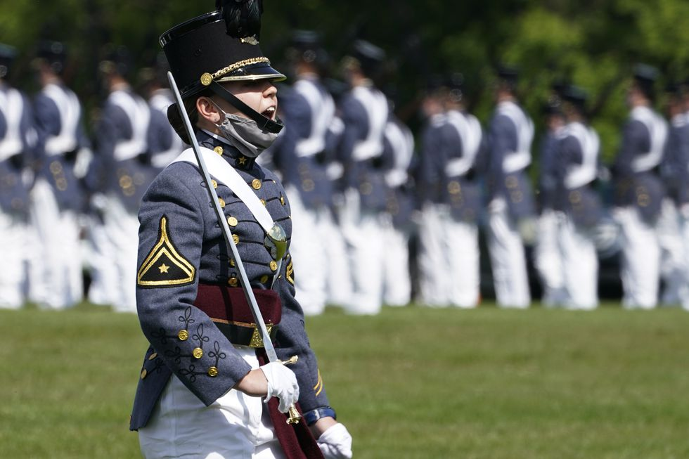Corps of Cadet Commander Kasey Meredith, of Johnstown, Pa., yells a command as she leads the...