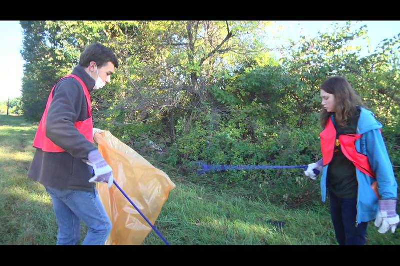 Students in Louisa County Public Schools picking up trash during their asynchronous work day.
