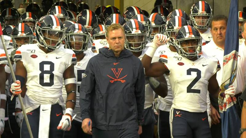 Bronco Mendenhall and the Cavaliers prepare to take the field at Pitt in 2019.