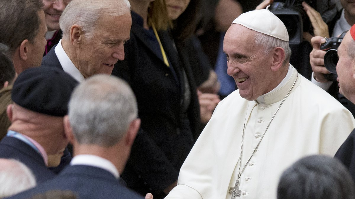 FILE - In this April 29, 2016, file photo Pope Francis shakes hands with Vice President Joe...