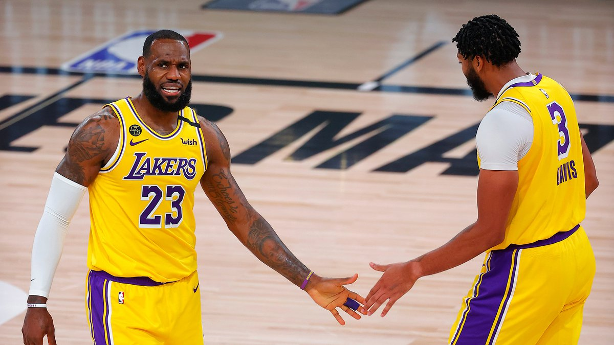Los Angeles Lakers' LeBron James, left, and Anthony Davis react after a shot during the third...