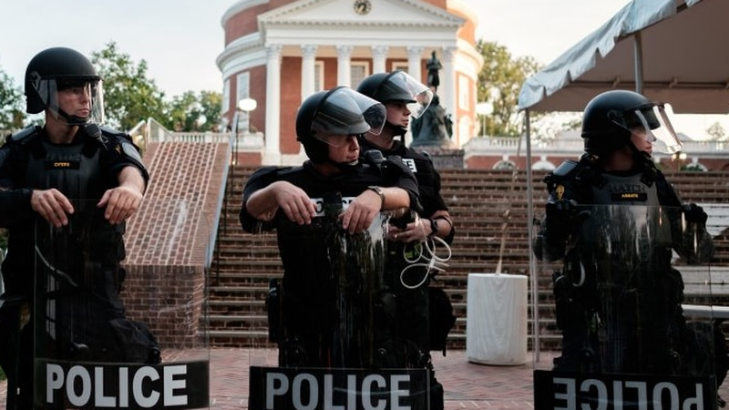 Police guarded the Rotunda at UVA on Aug. 11, 2018 in Charlottesville, the anniversary weekend...