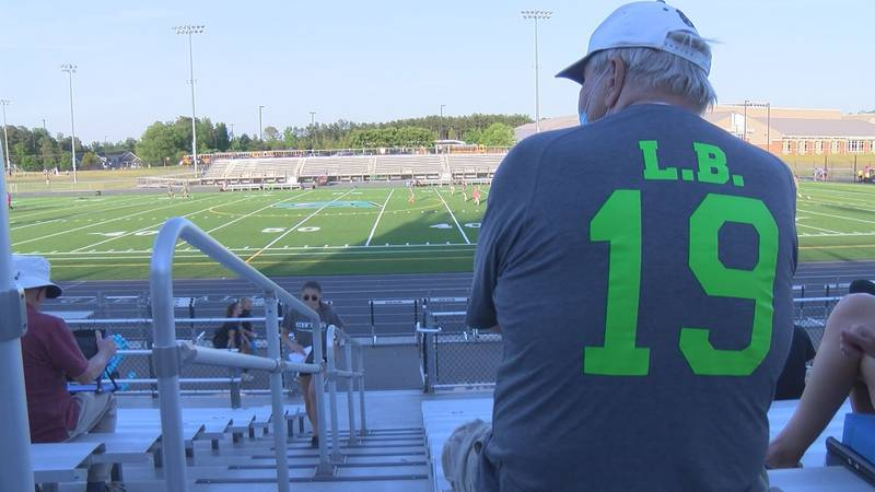 A fan wears a shirt in tribute of Lucia Bremer during a soccer game in her honor on May 21, 2021.