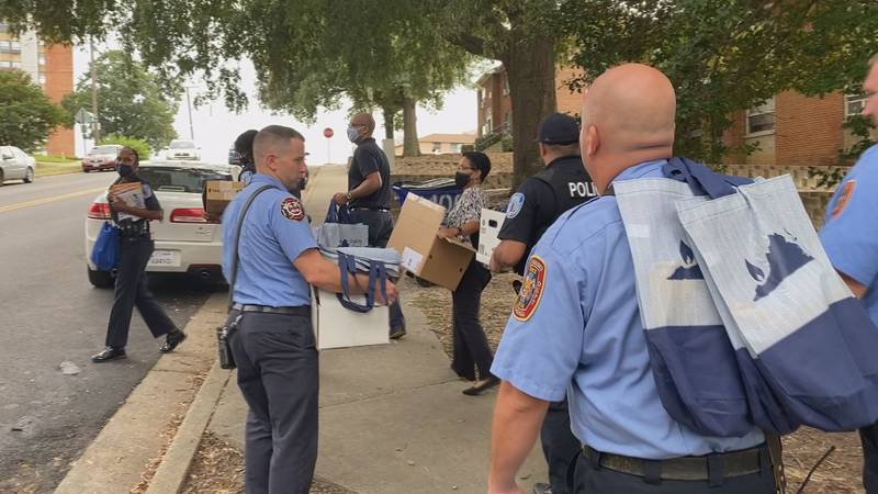 Local law enforcement distributed safety cards and spoke to residents of Gilpin Court educating...