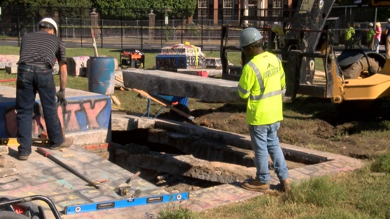 On Friday crews worked to reassemble the 21 pieces of granite following the search for the 1887...