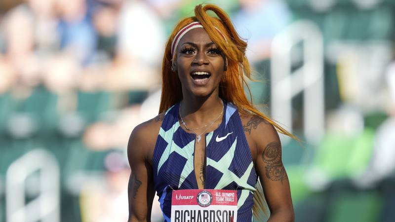 In this June 19, 2021 photo, Sha'Carri Richardson celebrates after winning the first heat of...