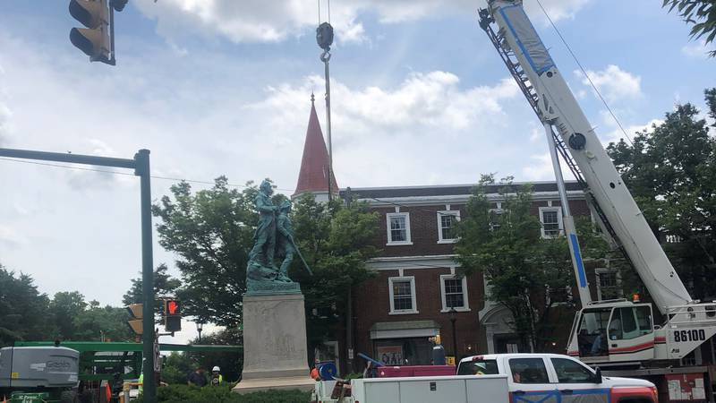 Lewis and Clark statue on West Main St. being removed around 2:30 p.m. Saturday.
