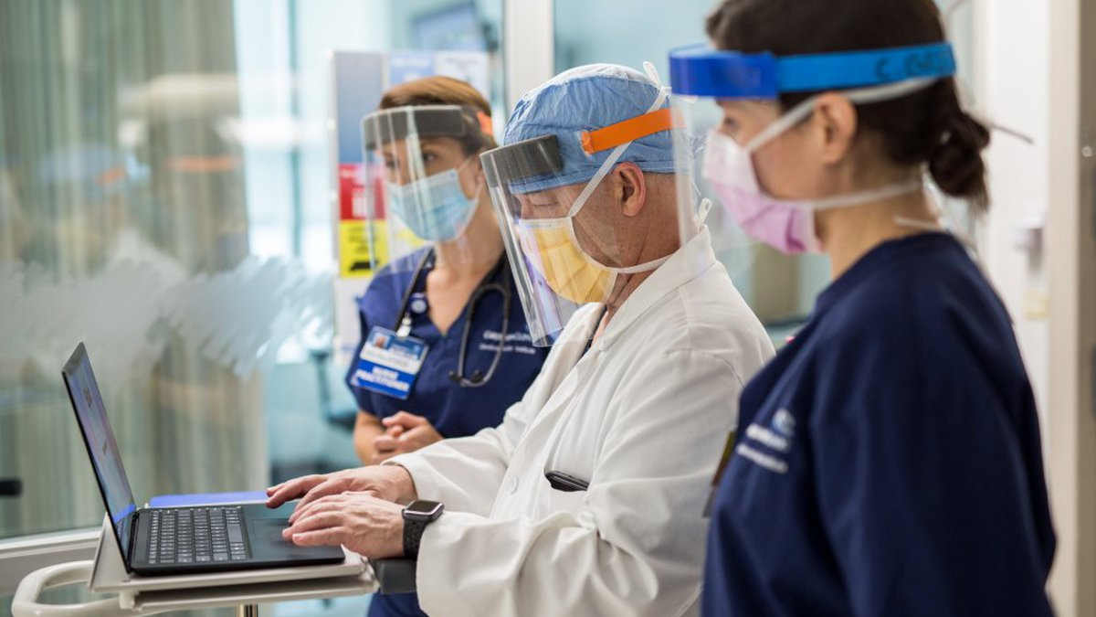 Physicians with the Carilion Clinic in Roanoke wear enhanced personal protective equipment...