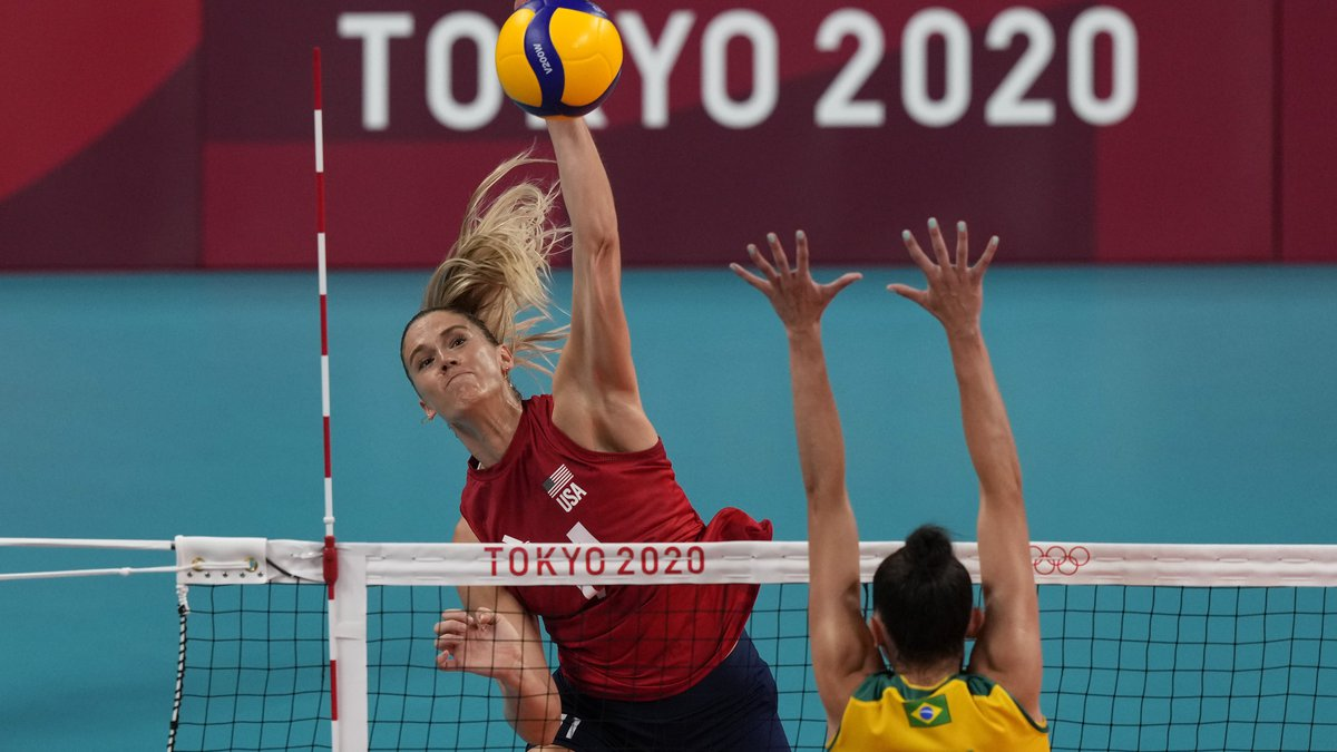 United States' Andrea Drews, above, spikes as Brazil's Gabriel Braga Guimaraes defends during...