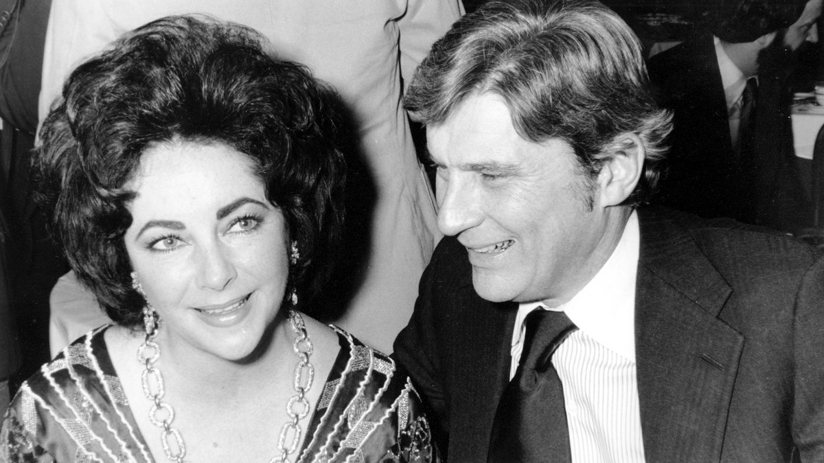 FILE - In this Jan. 30, 1977 file photo  actress Elizabeth Taylor and her husband, former...