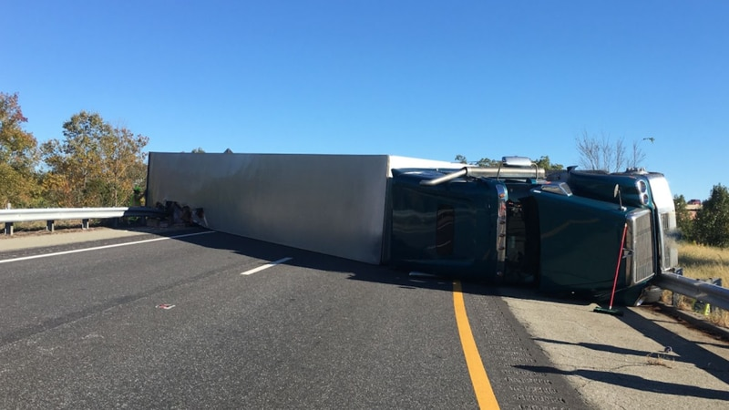 A tractor-trailer overturned on a ramp from Route 288 to Interstate 64 in Goochland County on...
