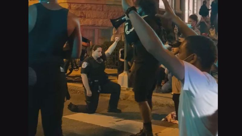 Tuesday night several Richmond Police officers took a knee in solidarity for those protesters...