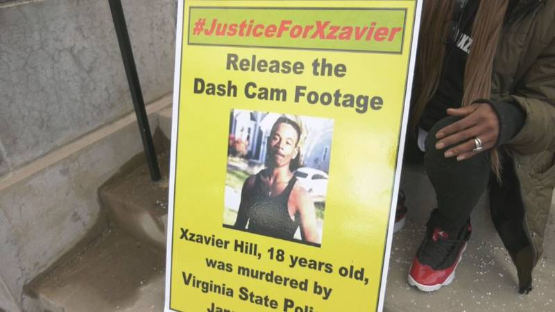A poster that reads #JusticeForXzavier at a rally at the University of Virginia.