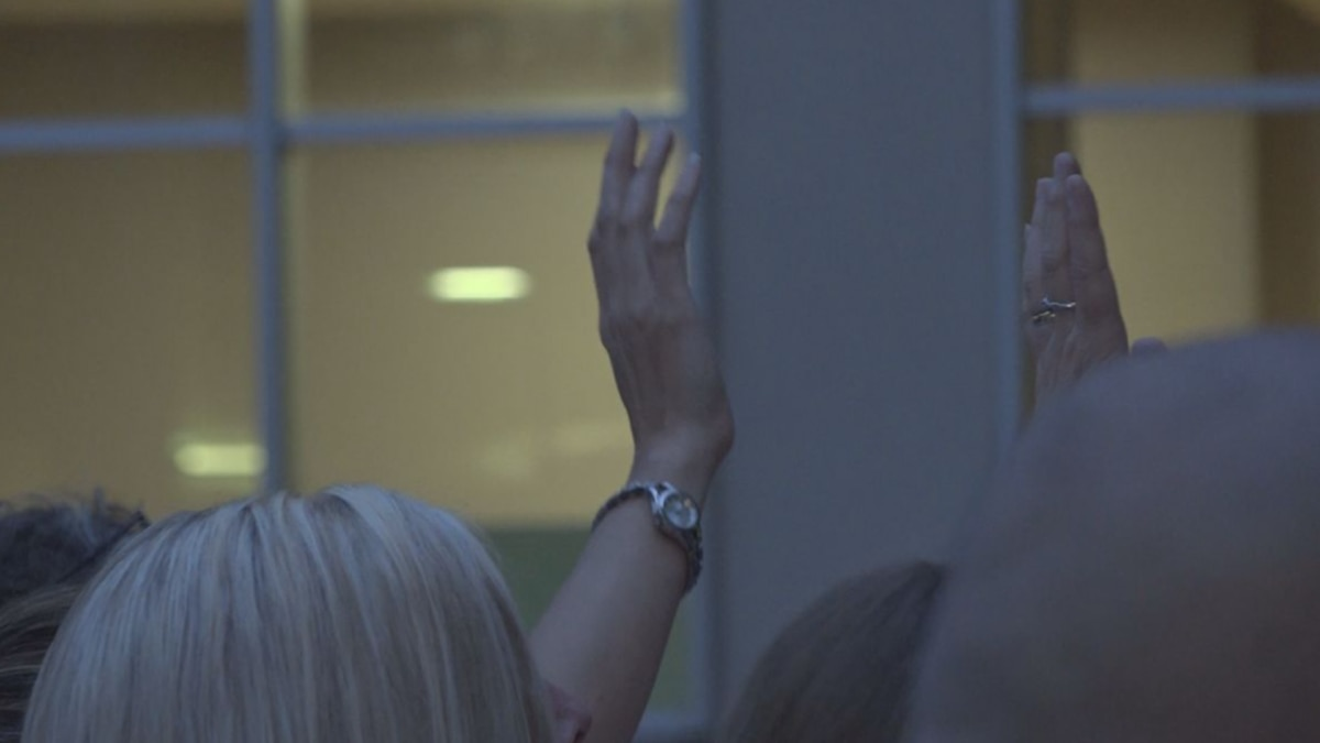 Community members gather outside hospital window nightly to pray for longtime pastor fighting...