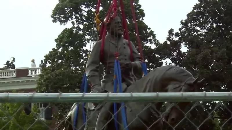 A statue of Gen. Robert E. Lee that towered over Richmond for generations was taken down, cut...