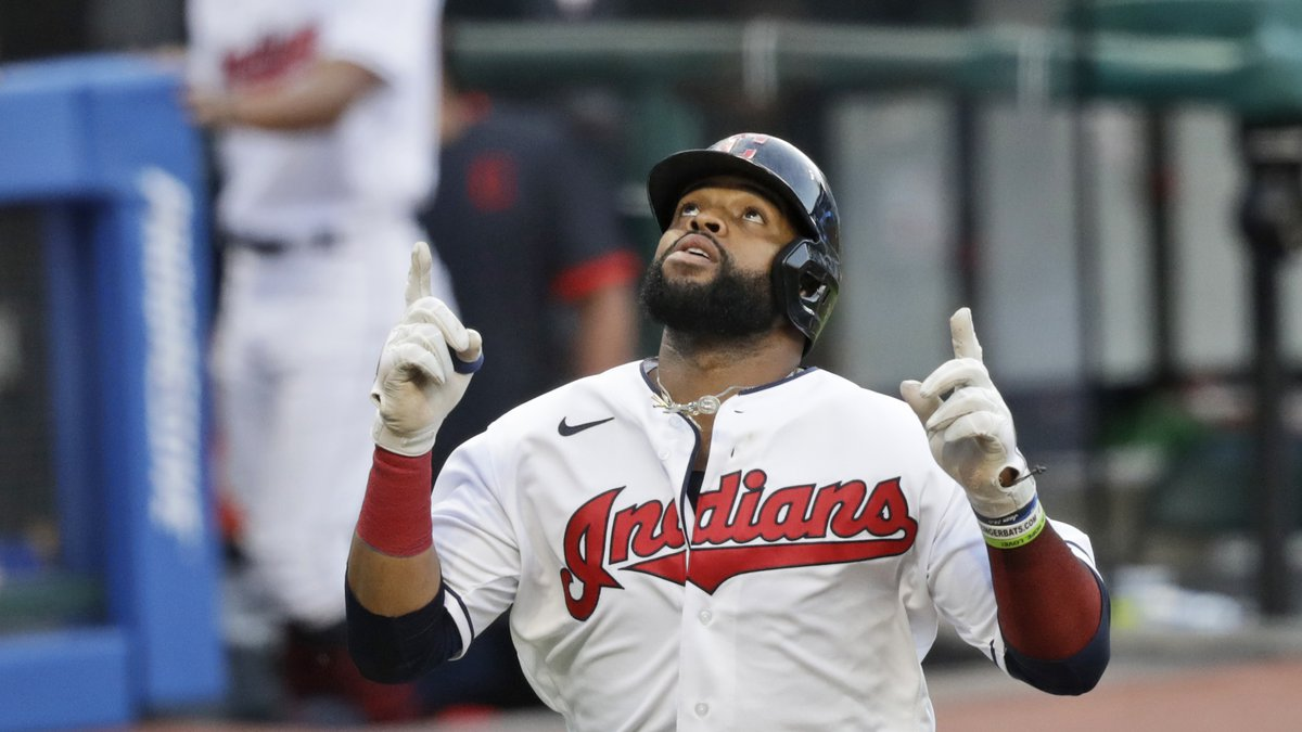 Cleveland Indians' Carlos Santana looks up after hitting a two-run home run in the first inning...