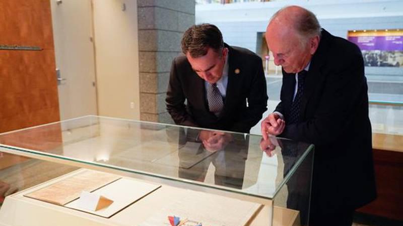 Governor Northam and Professor Howard viewing original copies of Virginia's Constitutions at...