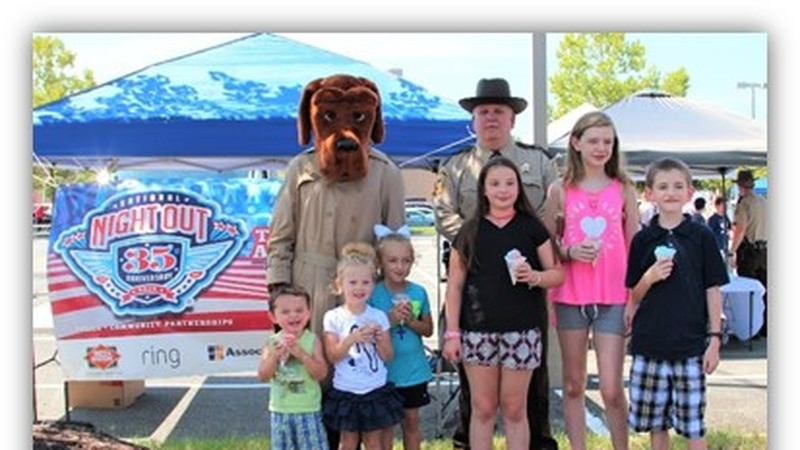 Kids pose with members of the Hanover Sheriff's Office during National Night Out.