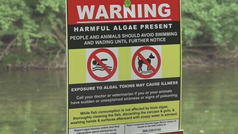 Signs hang at parts of the North Fork of the Shenandoah River.