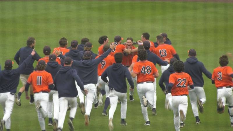 Senior Christian Hlinka is mobbed by his teammates after driving in the game-winning run.