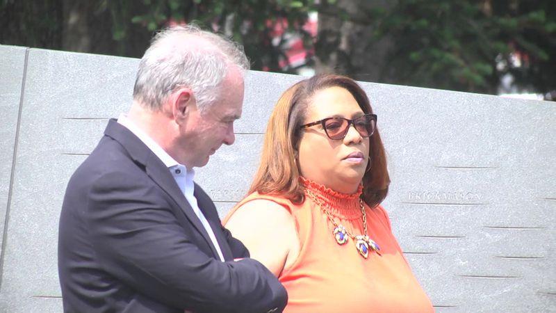 Senator Tim Kaine and Carolyn Mitchell Dillard walk along the Memorial to Enslaved Laborers at...