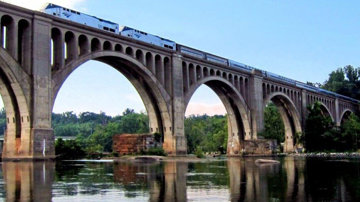 An Amtrak passenger train crosses the James River in Richmond.
